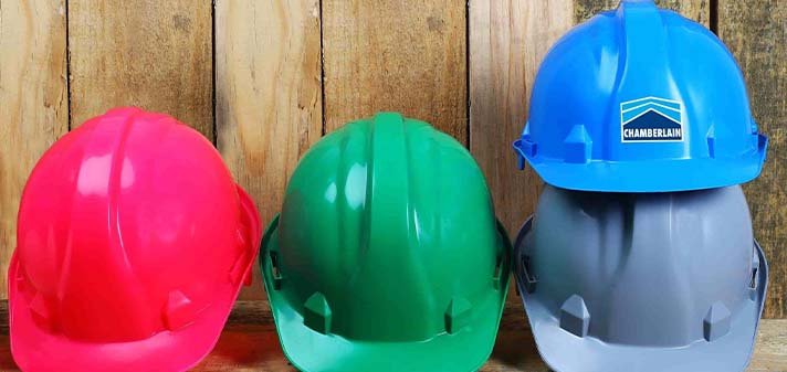 different coloured hard hats used for safety gear