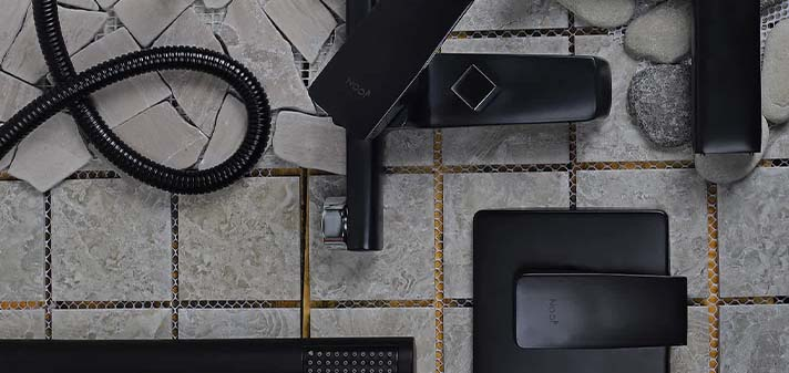 flat lay photography featuring an assortment of plumbing items, specifically taps and mixers